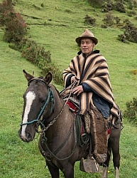Angel on his horse at  his farm in the high Andes, Ecuador