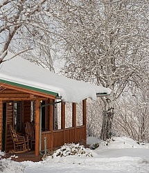 A Cabin in the Winter at The Hideout Guest Ranch